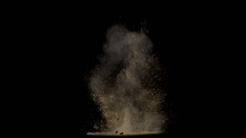 Dirt and dust particles explosion, Dirt Charge, sand particles detonates and floating over black background