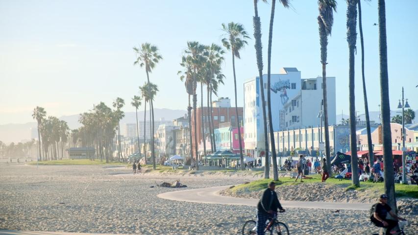 Venice , CA / United States - 05 27 2019: Lazy Sunny Day on Venice Beach Boardwalk