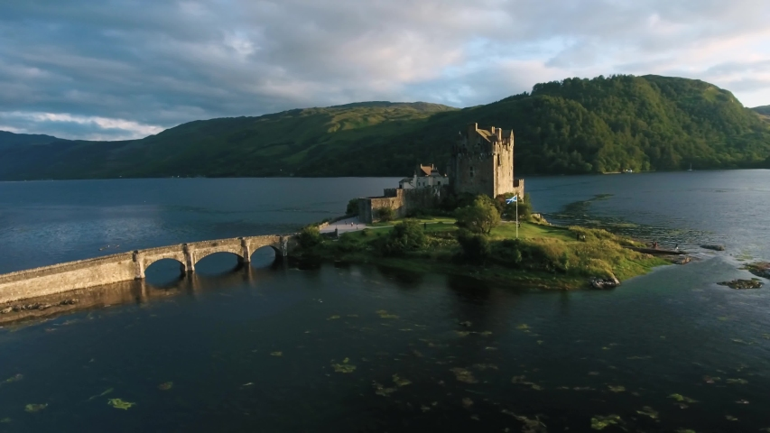 Famous Eilean Donan Castle in Scotland aerial shot from drone | Shutterstock HD Video #1035350615