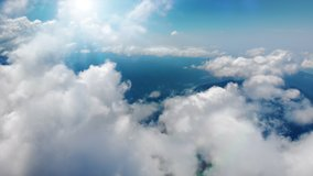 Flying through heavenly beautiful sunny cloudscape. Picturesque timelapse of white fluffy clouds moving softly on the clear blue sky in pure sunshine. Direct view from the cockpit.