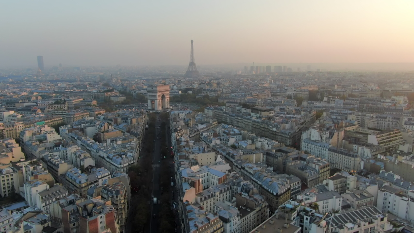 Aerial: Paris City Towards Arc de Triomphe and Traffic Circle, France | Shutterstock HD Video #1035380753