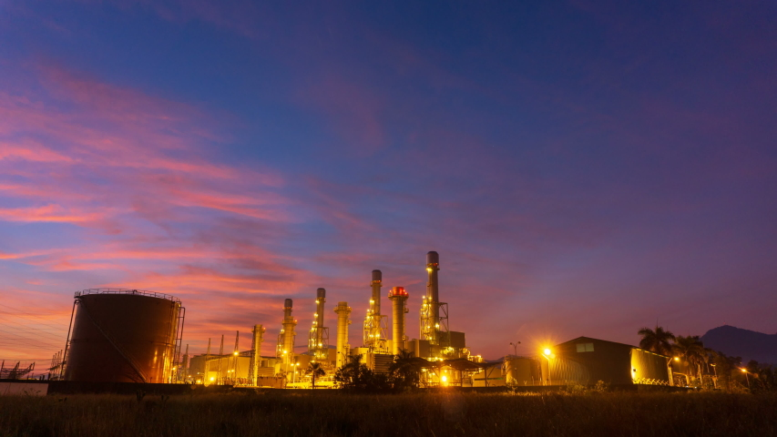 Time lapse: Industrial area, electricity supply substation during colorful sunrise.