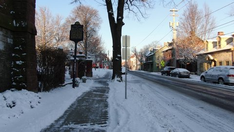 Walking along snow covered path towards historic Linden hall building in Lititz, Pennsylvania