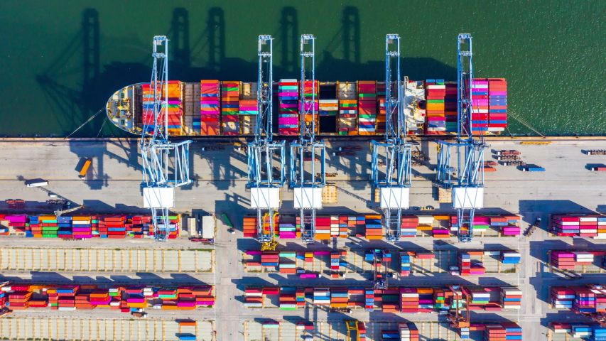Aerial view container cargo ship freight shipping unloading at original destination port with quay crane, Business commercial global oversea logistic import export container box by container vessel. | Shutterstock HD Video #1035419393