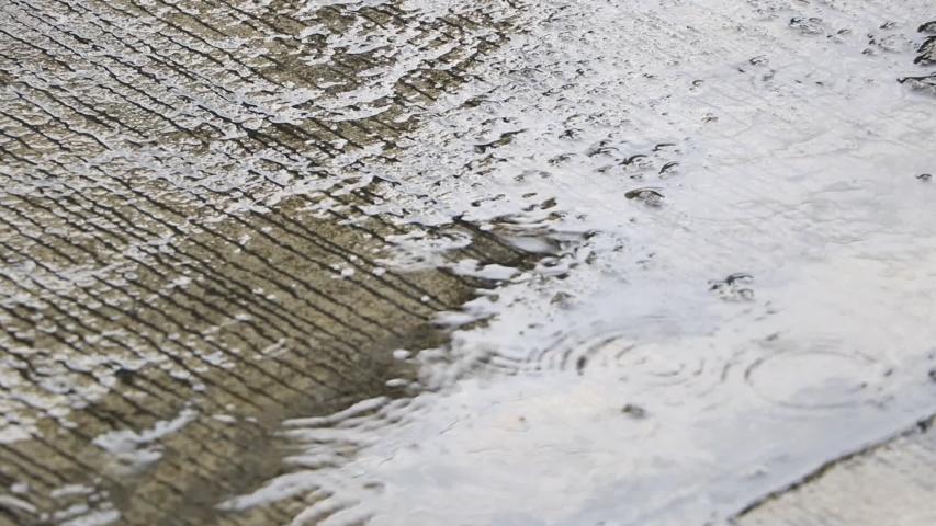 The Heavy rain drops on concrete floor    Shutterstock HD Video #1035422879