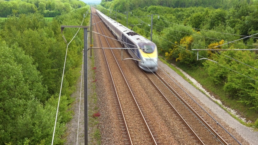 NORMANDY, FRANCE - CIRCA 2018 - A high speed electric passenger train passes through the countryside of Normandy, France.
