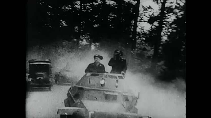 CIRCA 1940 - The Panzer Division advances across a French battlefield.