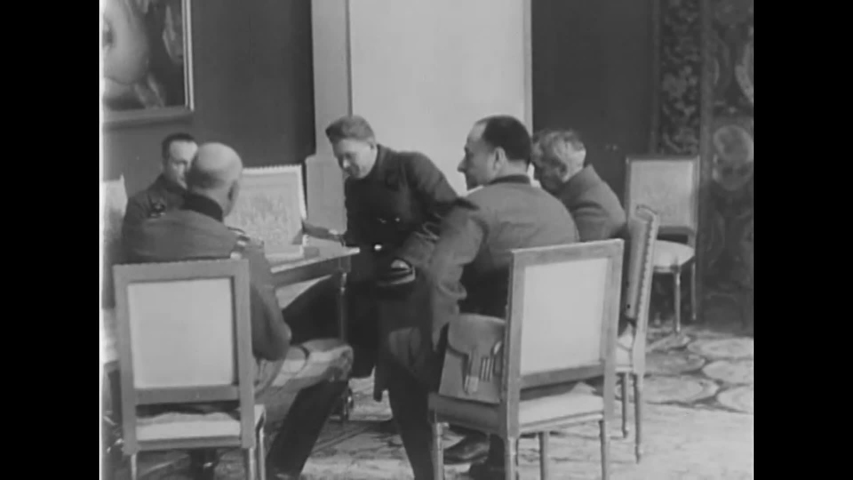 CIRCA 1939 - Russian and German officers meet to agree on the Molotov-Ribbentrop, or Non-Aggression, Pact.