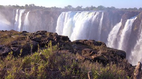 ZIMBABWE - CIRCA 2018 - Victoria Falls, mist rising in foreground, from the Zimbabwe side of the African waterfall.