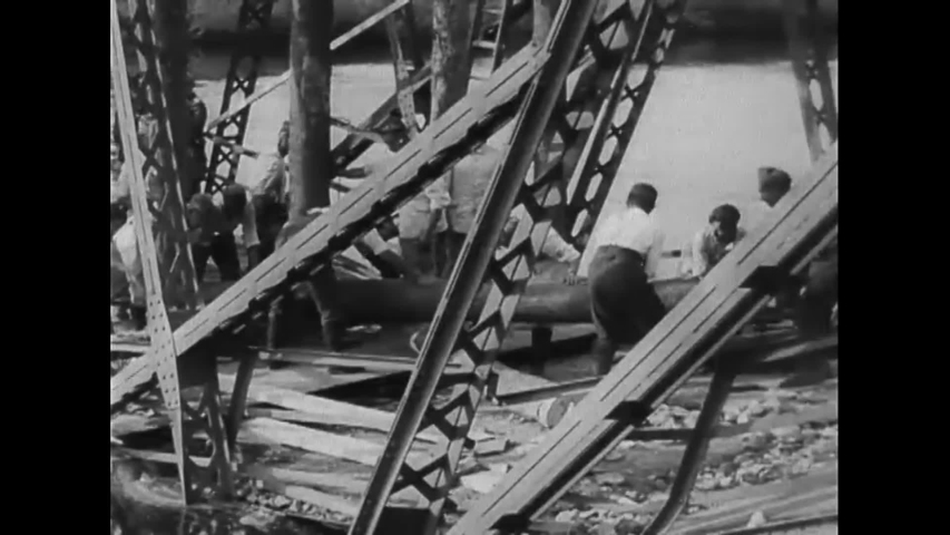 CIRCA 1939 - Bridges wrecked by warfare are shown in Poland. Polish POWs repair a bridge until it can be driven over again.