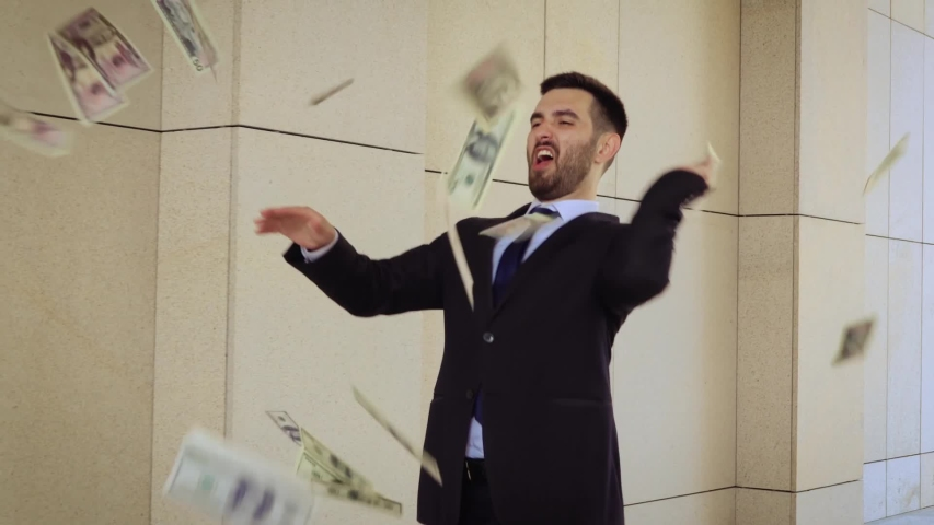 Young happy businessman dancing and throwing money. Slow motion. Successful business or winning the lottery | Shutterstock HD Video #1035480839