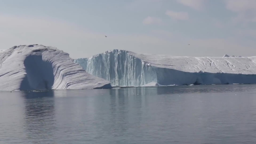 Ilulissat/Greenland  08/19/2019 photo of Large Iceberg Breaking in Greenland   Shutterstock HD Video #1035484919