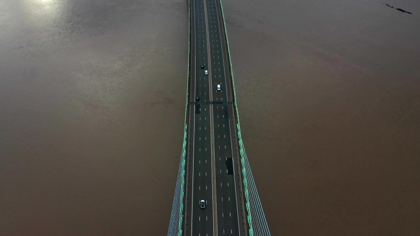 Birds eye view looking down on the Second Severn Crossing bridge over the River Severn | Shutterstock HD Video #1035493784