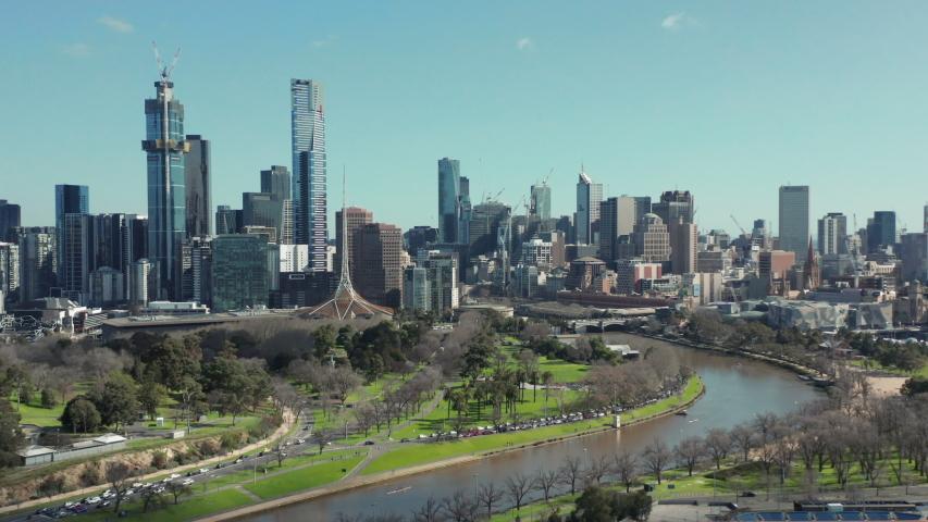 An aerial shot of Melbourne City, along the Yarra River past alexandra gardens towards CBD, Melbourne Australia