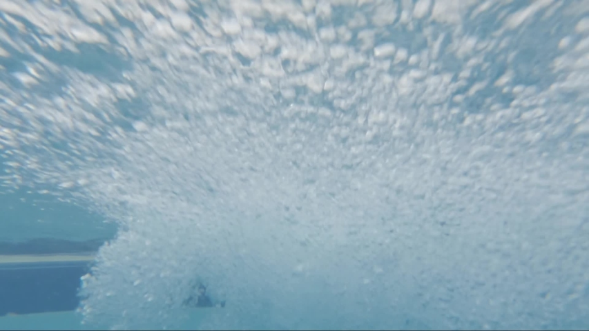 Underwater view of air bubbles comming from a jacuzzi jet   Shutterstock HD Video #1035507587
