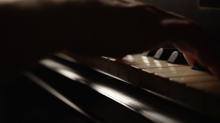 Hands of a male piano player on grand piano in low key light   Shutterstock HD Video #1035510122