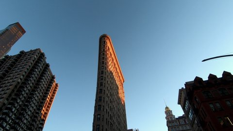 Buildings around and Flat Iron Building, Manhattan, New York City at sunset