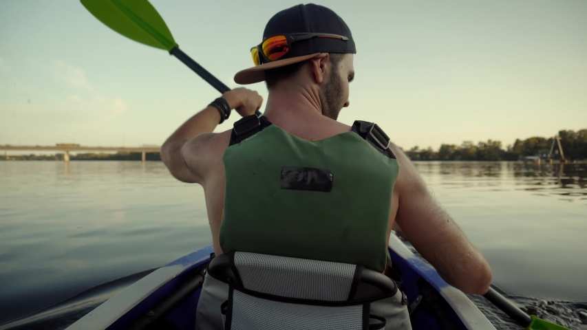 Man Floating In Boat On Vacation.Swimming Canoe In Life Vest.Strong Man Swim On Kayak Boat Fitness Workout With Oar.Travel Water Tourism Holidays Vacation.Tourist Explores River In Kayak.Sport Rowing. | Shutterstock HD Video #1035518864