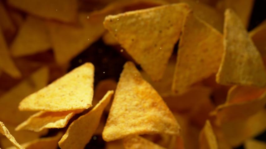 Super slow motion of flying tortilla chips on black background. Filmed on high speed cinema camera, 1000 fps.   Shutterstock HD Video #1035563981
