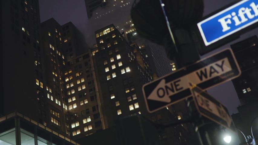 Subway train passing Manhattan bridge in New York in the evening    Shutterstock HD Video #1035577259