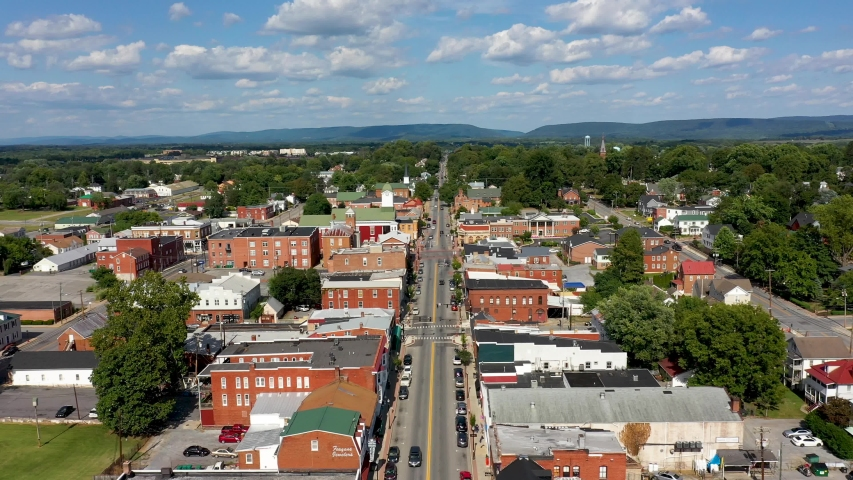 Aerial flyover main street toward the Jefferson County courthouse in Charles Town, West Virginia on a beautiful sunny day.