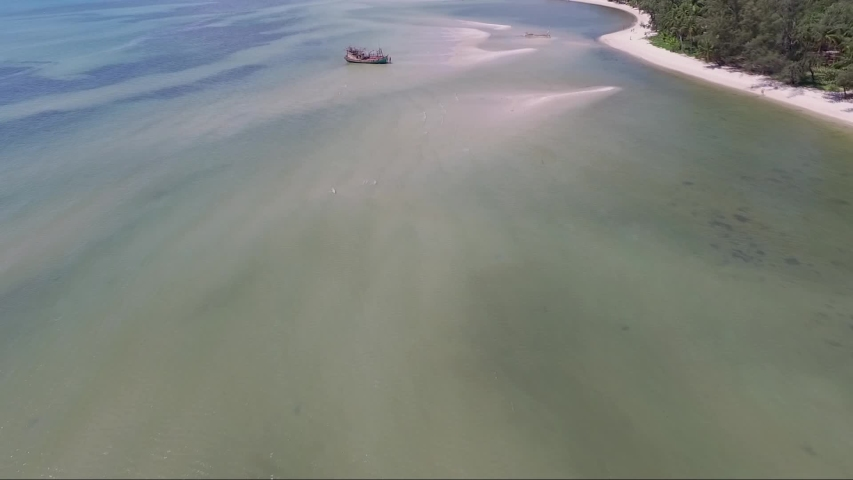 Aerial shot of a boat being stuck on the sandbank nearby the Koh Samui island in Thailand | Shutterstock HD Video #1035593159