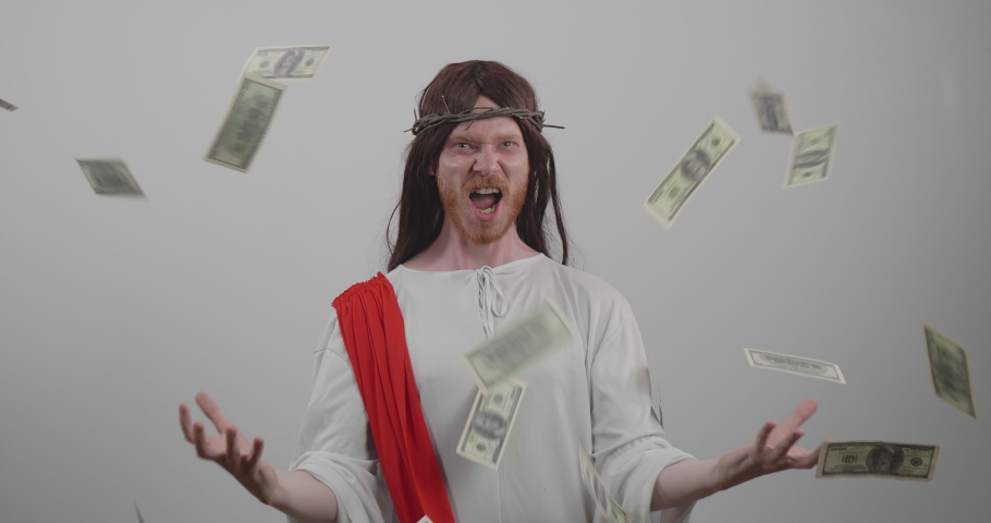 Greedy Jesus standing in money rain, feeling excited and powerful isolated on white background | Shutterstock HD Video #1035621980