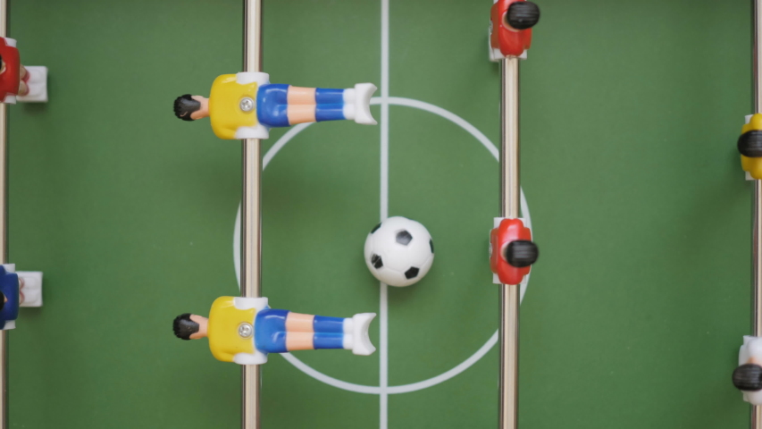 Friends Playing Table Soccer Game Closeup. People playing in table football or kicker with miniature players. Slow Motion. Shallow DOF. Playing Football Soccer on game table. Close Up. | Shutterstock HD Video #1035657932