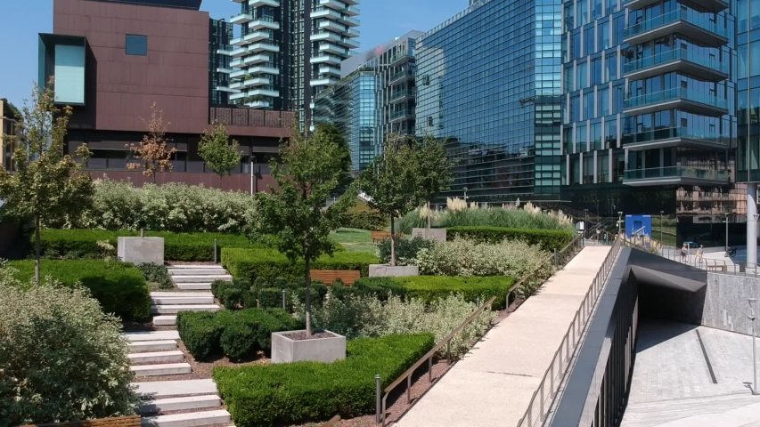 Modern architecture in the new business center of Milan on the promenade of Porta Nova Varezine. Office buildings. Shooting with a drone. Modern houses made of concrete and glass. Lombardy | Shutterstock HD Video #1035660797
