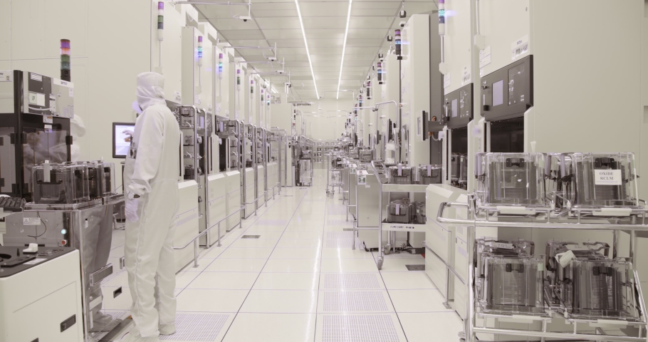 Clean room manufacturing of silicon wafers for the semiconductors industry Royalty-Free Stock Footage #1035694985