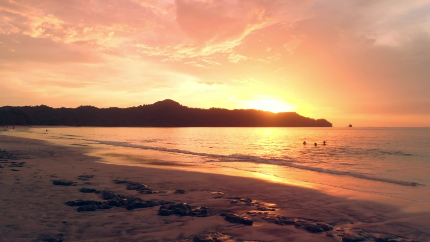 Drone flight forward into the sunset at Conchal beach, Costa Rica.  | Shutterstock HD Video #1035734162