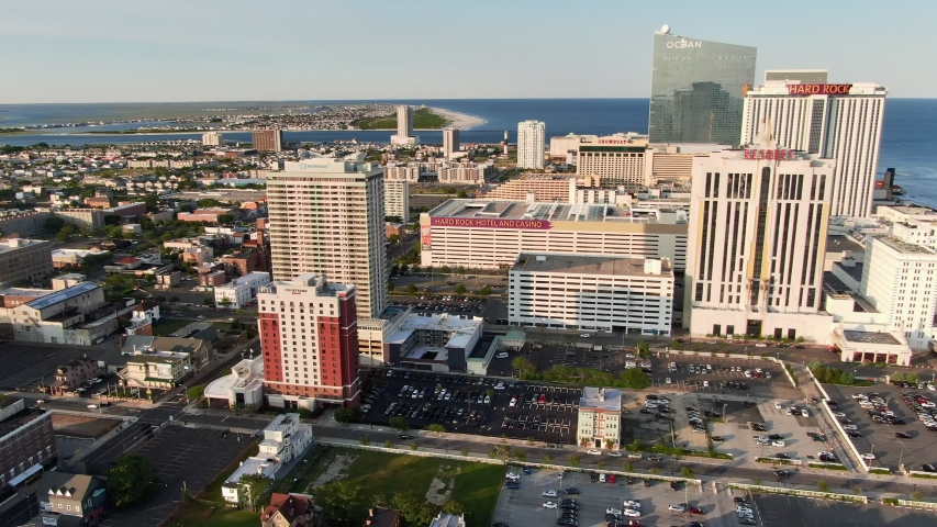 Atlantic City , New Jersey / United States - 06 03 2019: Gambling and leisure seaside resort in Atlantic City, New Jersey, aerial view of beachfront boardwalk with hotels and casinos