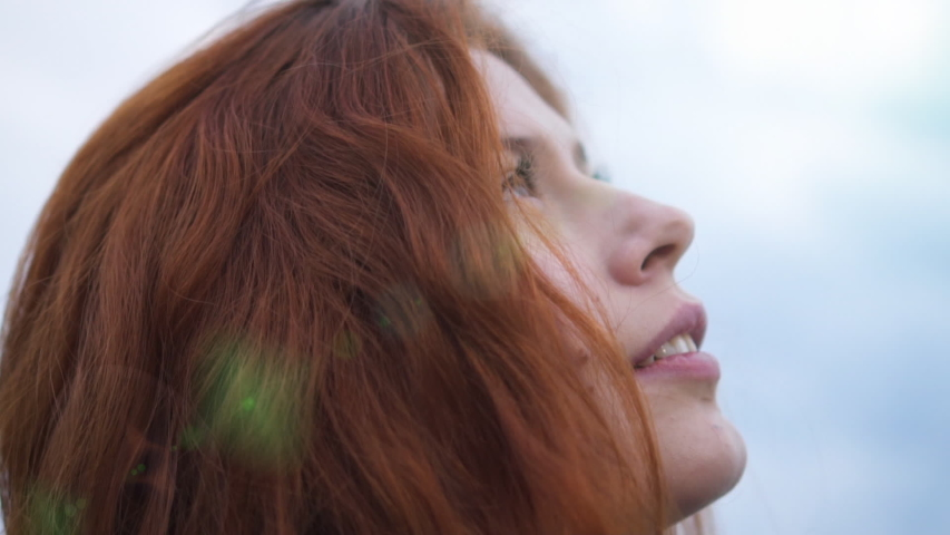 Redhead Young Woman Looking Up To Sunset Sky With Hope Pray Prayer Sun Flare | Shutterstock HD Video #1035742577
