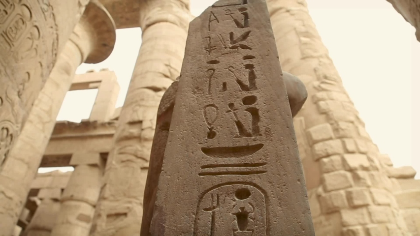 Big columns and deck with hieroglyphs at Luxor Temple, Egypt | Shutterstock HD Video #1035763580