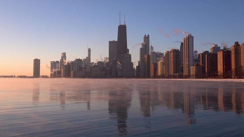 Early morning of Chicago skyline with sea smoke on Lake Michigan during polar vortex timelapse 4k