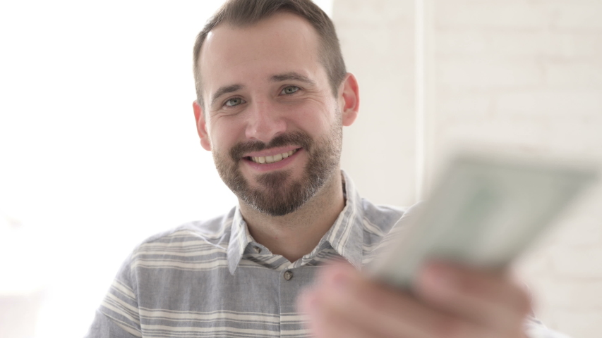 Adult Young Man Giving Dollar Paper Currency | Shutterstock HD Video #1035770612