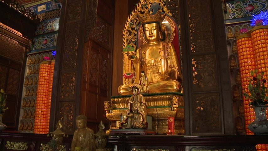 Wide low-angle tilting shot of golden buddha statues and beautiful artistic interior sculptures and decorations, Kek Lok Si Temple, Georgetown, Penang, Malaysia   Shutterstock HD Video #1035819380