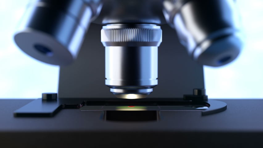 Close-up shot of automated scientific laboratory microscope examining a drop of blood on a prepared sample slide. Seamless loopable animation can be used in education, science or medicine industry