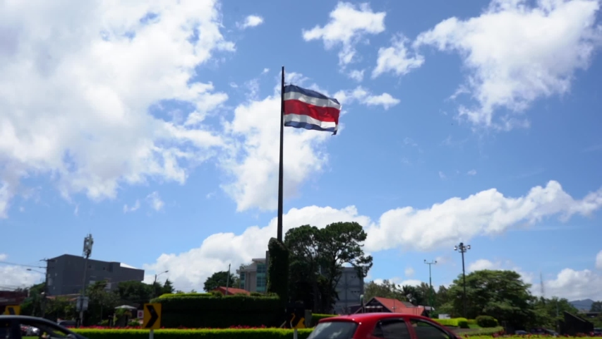 Beautiful cinematic view of the Costa Rica Flag on Movement | Shutterstock HD Video #1035848462