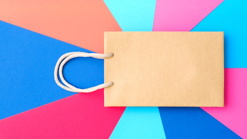 Black friday. Shopping final sale. Paper bag brand mockup. Vibrant colorful background. | Shutterstock HD Video #1035892985