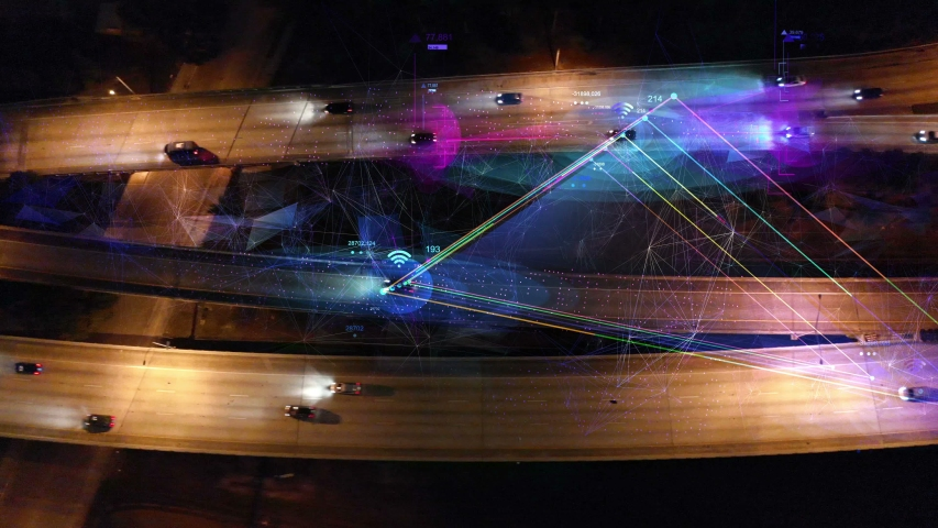 Self driving cars driving on a highway. Top view of Autopilot car on free way with technology tracking. Future transportation, Technology concept of traffic surveillance system in highway in 4K