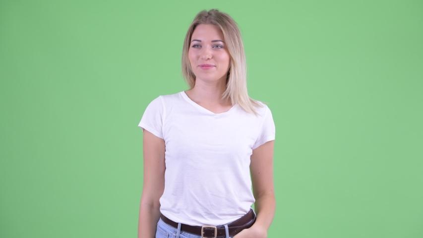 Happy young beautiful blonde woman waving hand | Shutterstock HD Video #1035919805