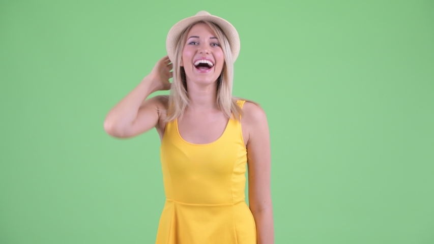 Happy young blonde tourist woman smiling and laughing | Shutterstock HD Video #1035919850