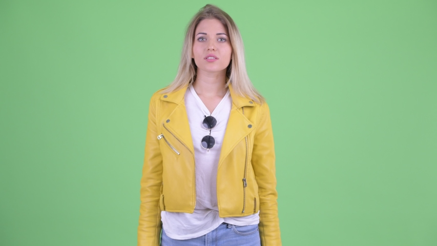 Happy young rebellious blonde woman blowing kiss | Shutterstock HD Video #1035920036