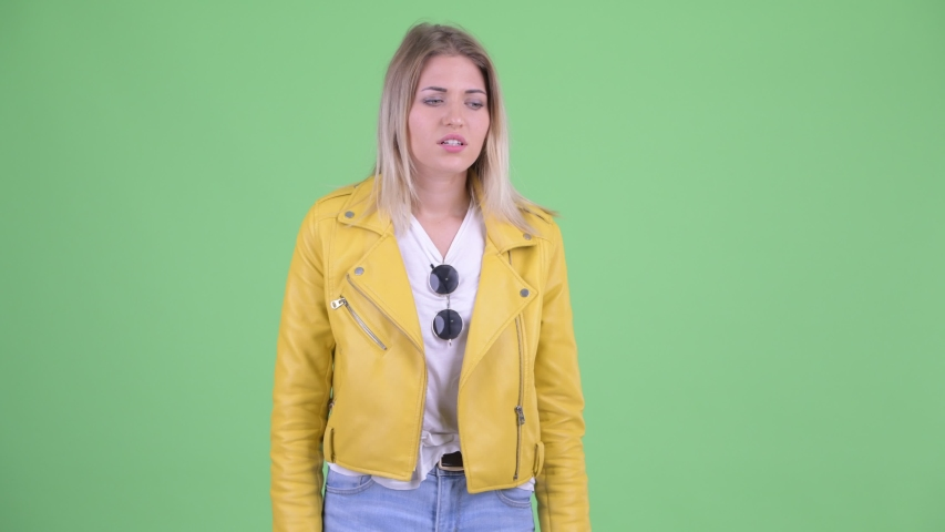 Stressed young rebellious blonde woman having stomachache | Shutterstock HD Video #1035920039