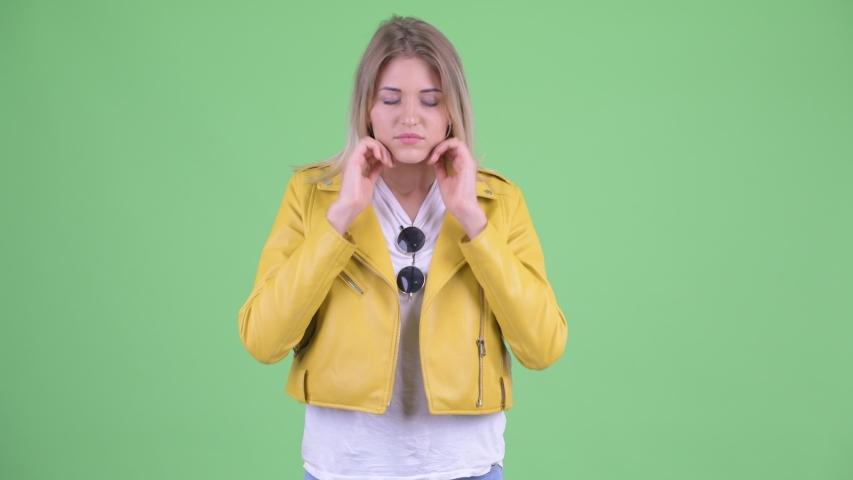 Stressed young rebellious blonde woman having headache | Shutterstock HD Video #1035920048