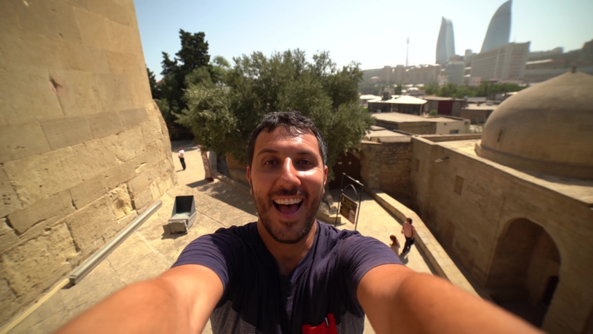 happy tourist take selfie photo in Baku, Capital of Azerbaijan. Travelling in Caucasus country