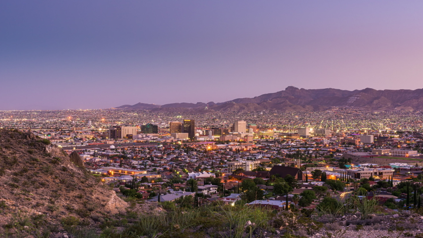 El Paso, Texas, USA downtown city skyline from dusk till night with Ciudad Juarez, Mexico visible in the distance.