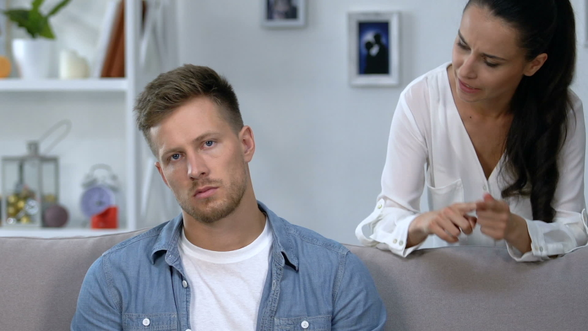 Furious woman arguing with upset husband ignoring her, relationship crisis | Shutterstock HD Video #1035994982
