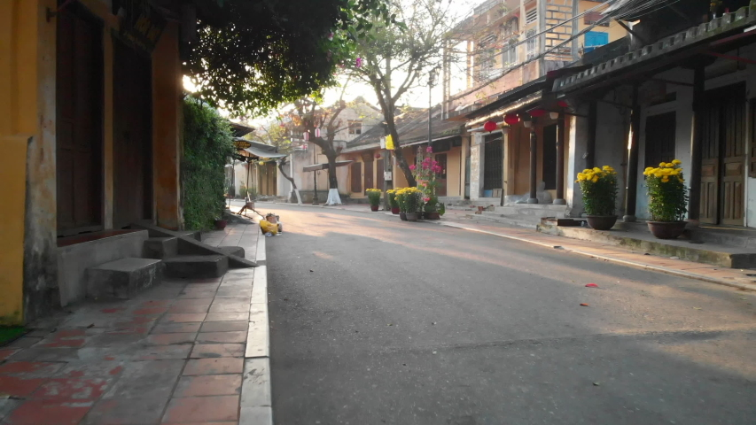 Walk through empty streets of Hoi An ancient town at sunrise